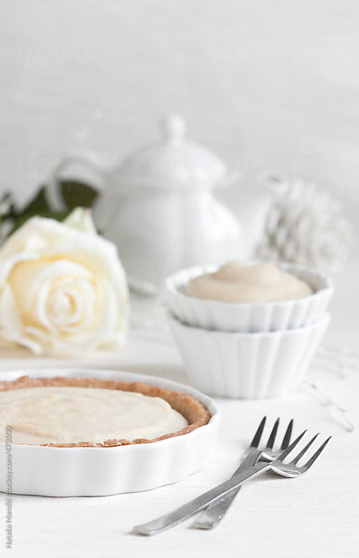 White cake with white decorations by Nataša Mandić for Stocksy United