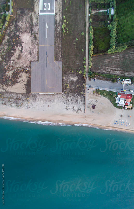 Landing strip and beach seen from above by Luca Pierro for Stocksy United