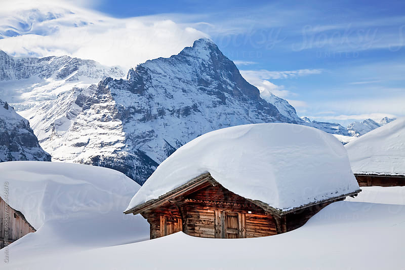 Snow covered building in front of the North Face of the Eiger, Grindelwald, Jungfrau region, Bernese Oberland, Swiss Alps, Switzerland by Gavin Hellier for Stocksy United