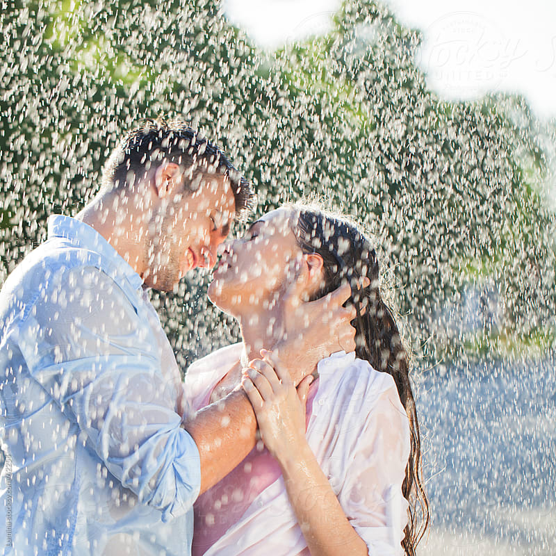Couple Kissing in the Summer Rain by Lumina for Stocksy United