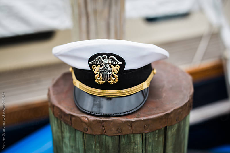 Military naval officer's lid on pier piling by Matthew Spaulding for Stocksy United