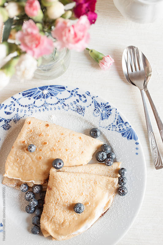 Crepes with creamy filling and blueberries by Nataša Mandić for Stocksy United