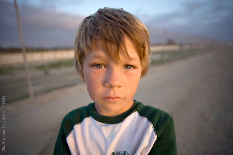 Wide Angle View Of Boy on Dirt Road by Dina Giangregorio for Stocksy United