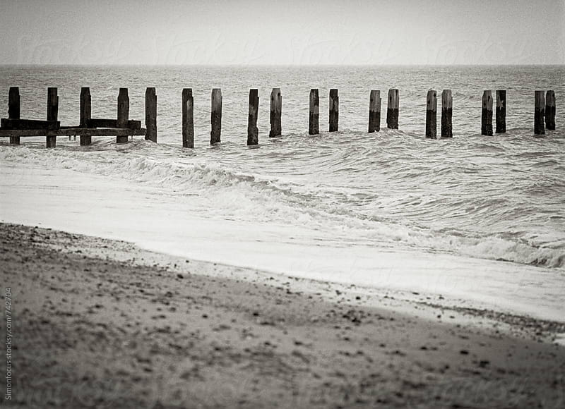 Southwold beach and pilings by Simon DesRochers for Stocksy United