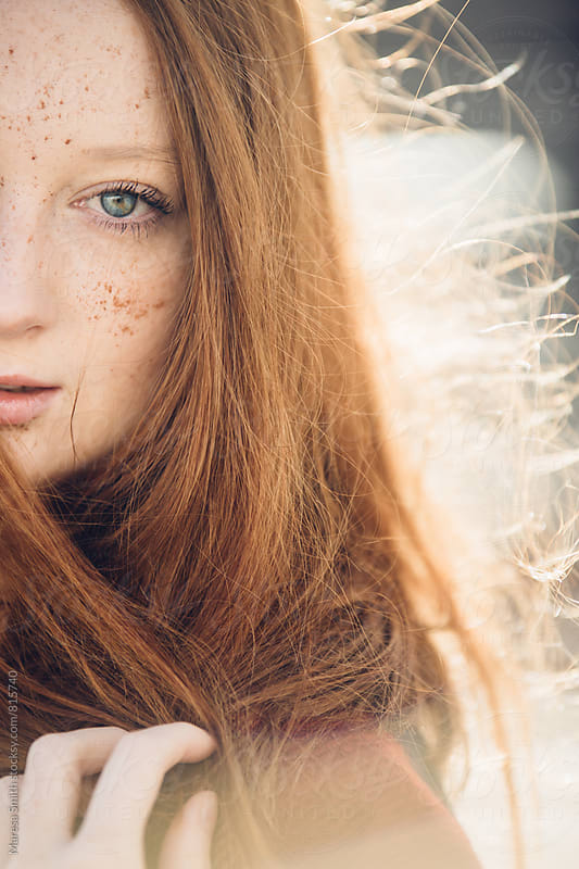 Half portrait of a ginger haired woman with blue eyes by Maresa Smith for Stocksy United