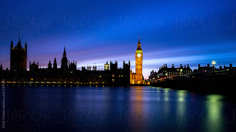 The Big Ben bright at night by Chris Chabot for Stocksy United