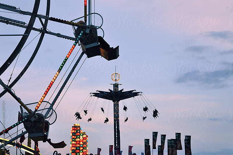 amusement park rides at dusk by Amanda Large for Stocksy United