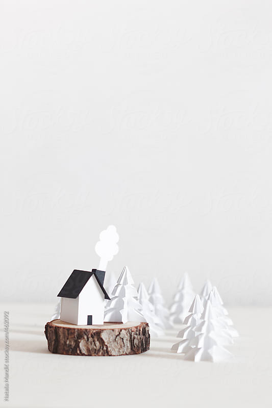 Origami christmas trees and a little house by Nataša Mandić for Stocksy United