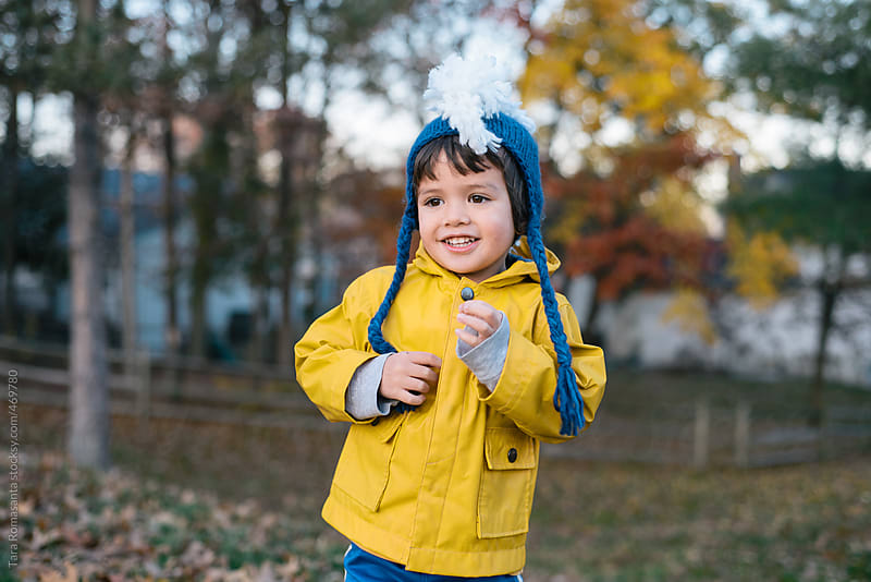 boy in a silly hat happy to be outside in autumn by Tara Romasanta for Stocksy United
