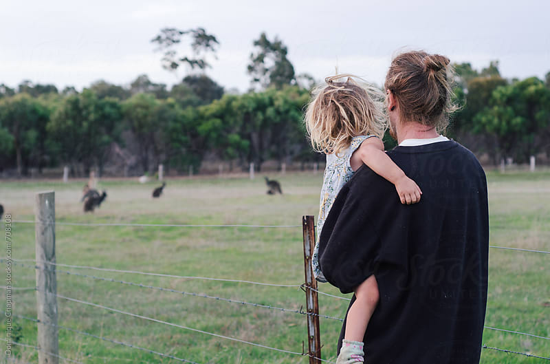 Father and daughter watching kangaroos by Dominique Chapman for Stocksy United