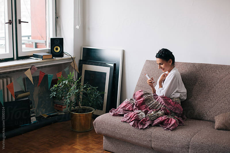 Woman in her flat by Marija Mandic for Stocksy United