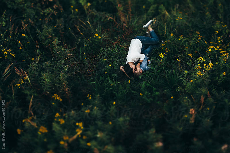 Mother and boy laying in the grass by Evgenij Yulkin for Stocksy United