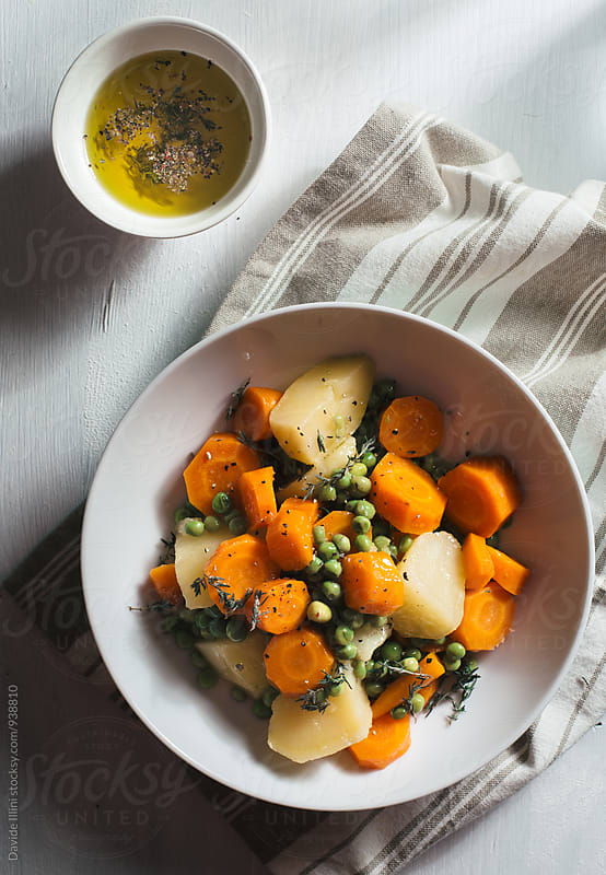 Vegan salad with potatoes green beans and carrots. by Davide Illini for Stocksy United