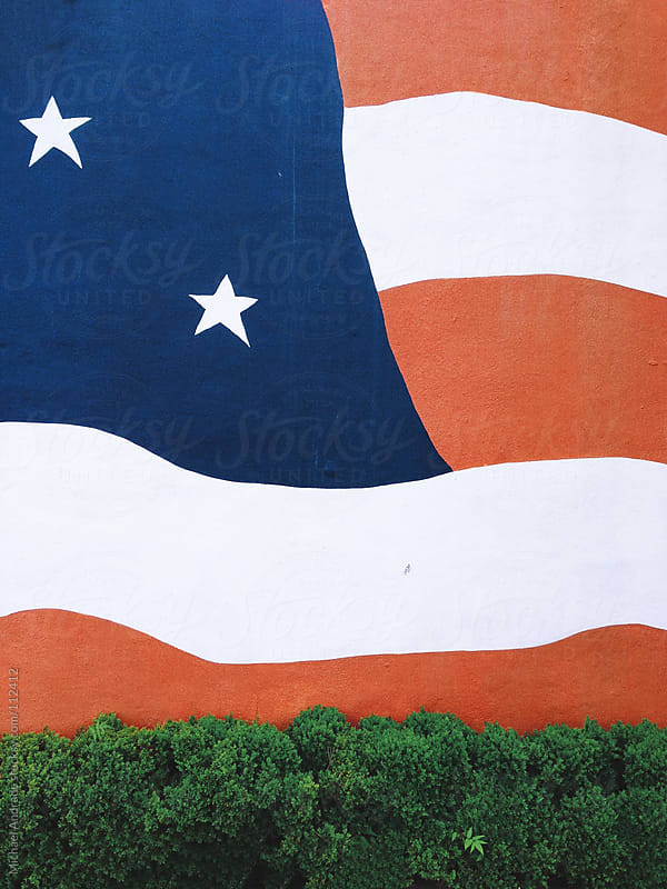 American flag painted on a wall by Michael Villegas for Stocksy United