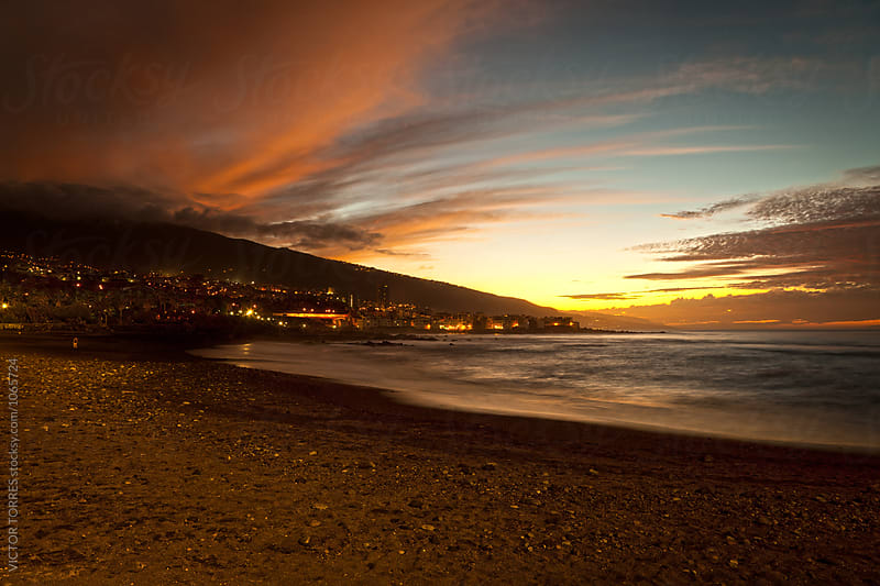 Sunset in Playa Jardin, Puerto de la Cruz, Tenerife by Victor Torres for Stocksy United