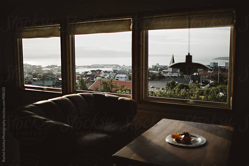 City Landscape Outside Living Room Window by Rachel Gulotta Photography for Stocksy United