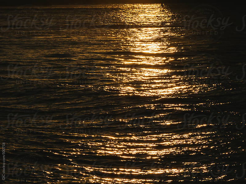 Sunset reflection on the waves by GIC for Stocksy United