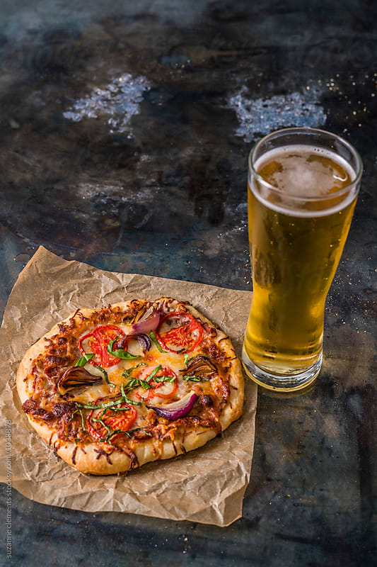 Ice Cold Beer and Pizza Dinner by suzanne clements for Stocksy United