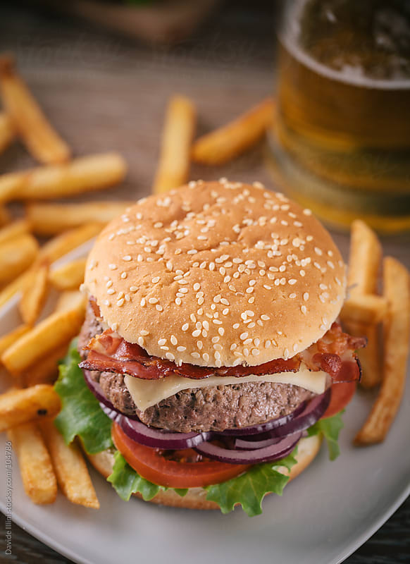 Hamburger with french fries by Davide Illini for Stocksy United