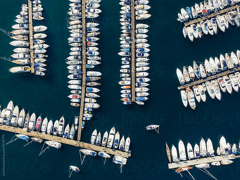 Boats Docked in a Marina by Lumina for Stocksy United