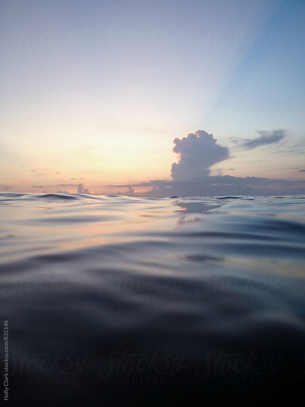 Beautiful Caribbean waves at twilight by Holly Clark for Stocksy United