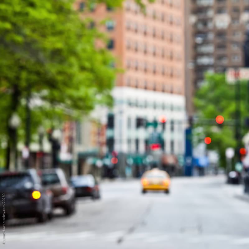 Out of focus chicago with taxi by Thomas Hawk for Stocksy United