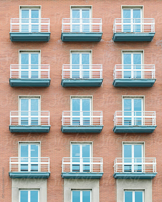 Windows with balcony on a skyscraper by GIC for Stocksy United