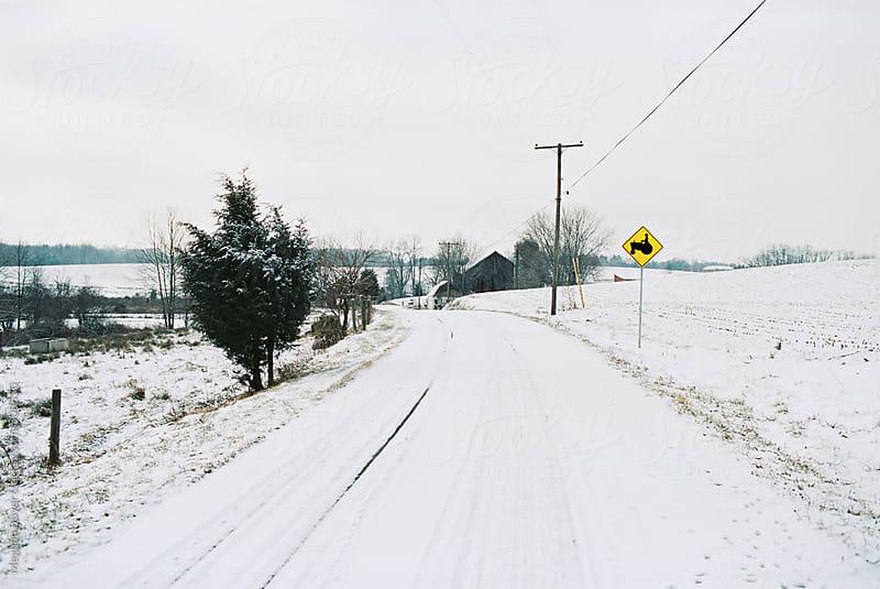 Snowy farmland in the winter by Meghan Boyer for Stocksy United