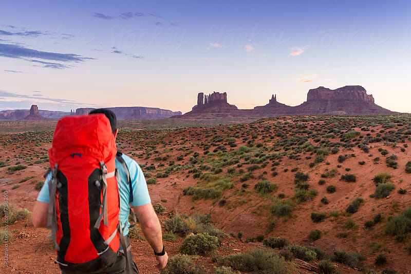 Man Backpacking In Monument Valley Utah At Dusk by JP Danko for Stocksy United