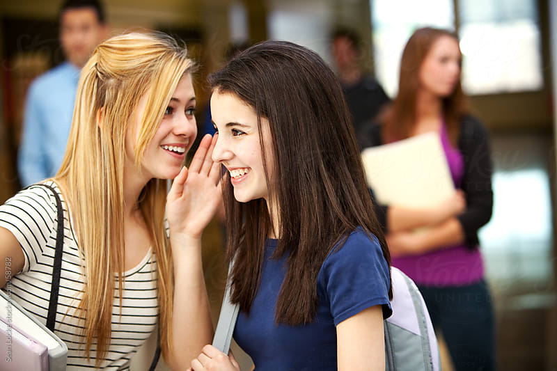 High School: Two Girls Spreading Gossip by Sean Locke for Stocksy United