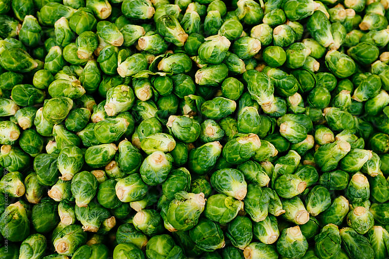 Brussels Sprouts piled high at a local California Farmer's Market. by Lucas Saugen for Stocksy United