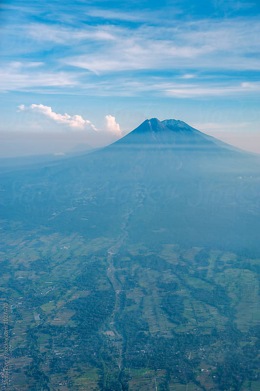 Volcano from the window of airplane by Sasha Evory for Stocksy United