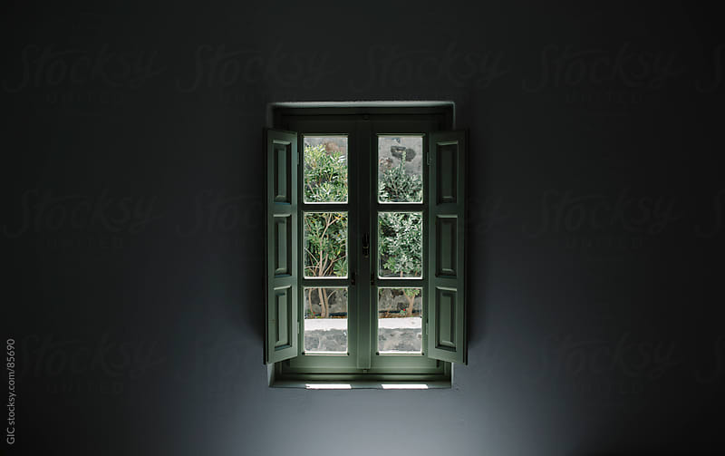 Green window in the wall by GIC for Stocksy United