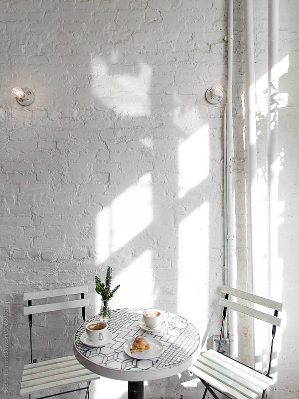 White table with coffee and crossaint by Sophia Hsin for Stocksy United