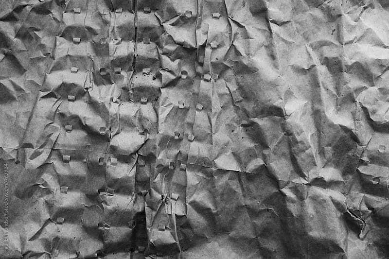 Detail of crumpled paper by Paul Edmondson for Stocksy United