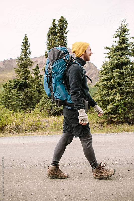 Denali Backpacker On The Move by Luke Mattson for Stocksy United
