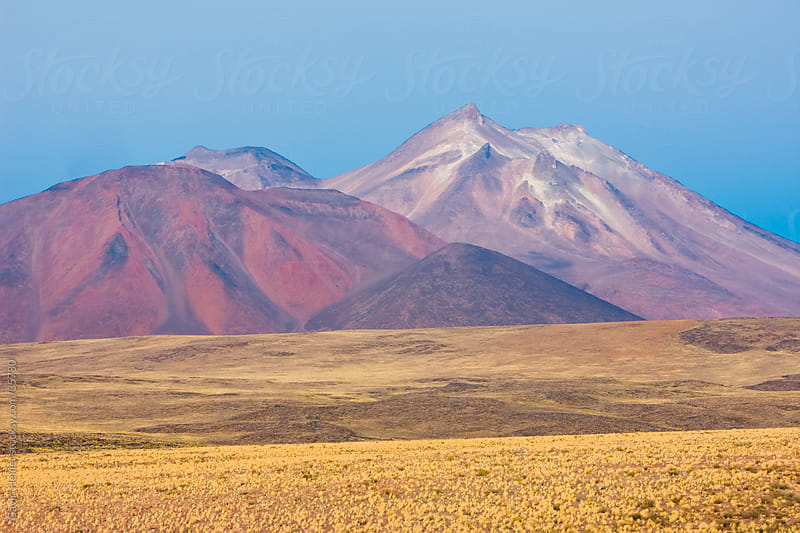 South America, Chile, Norte Grande, Antofagasta Region, Atacama desert, Los Flamencos National Reserve, the altiplano at an altitude of over 4000m and the peak of Cerro Miniques at 5910m by Gavin Hellier for Stocksy United