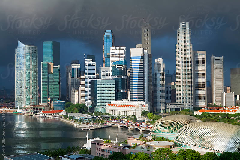 Asia Singapore Singapore Skyline Financial district illuninated under a stormy sky by Gavin Hellier for Stocksy United