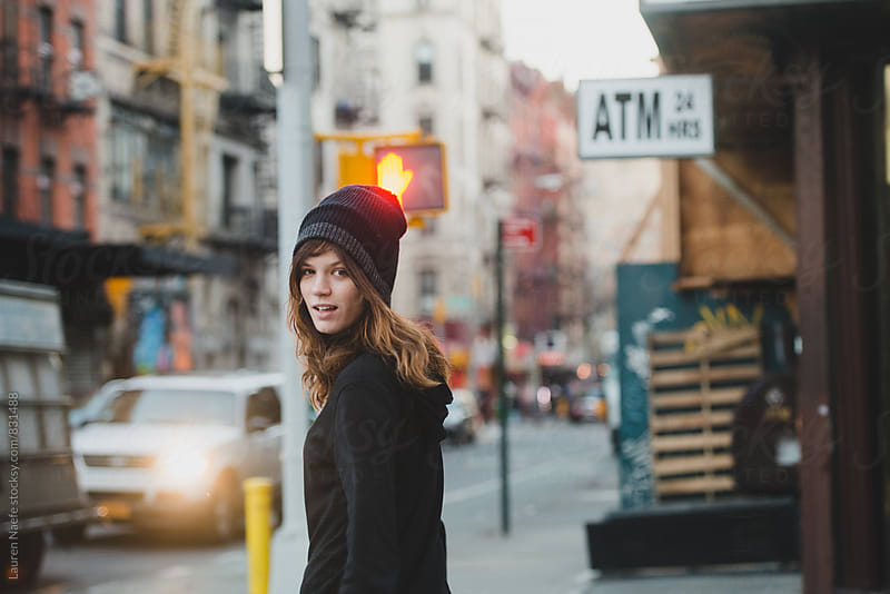 Young woman walking in the city by Lauren Naefe for Stocksy United