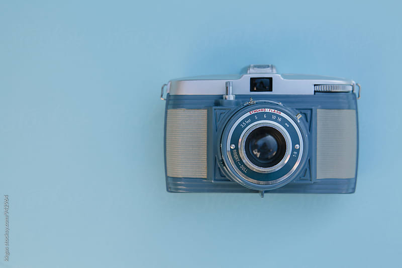 Blue vintage camera on a blue background by kkgas for Stocksy United