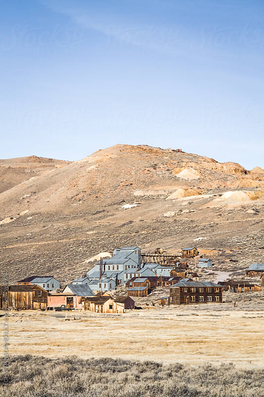 Sprawling Landscape with Gold Rush Era Ghost Town by Meg Pinsonneault for Stocksy United