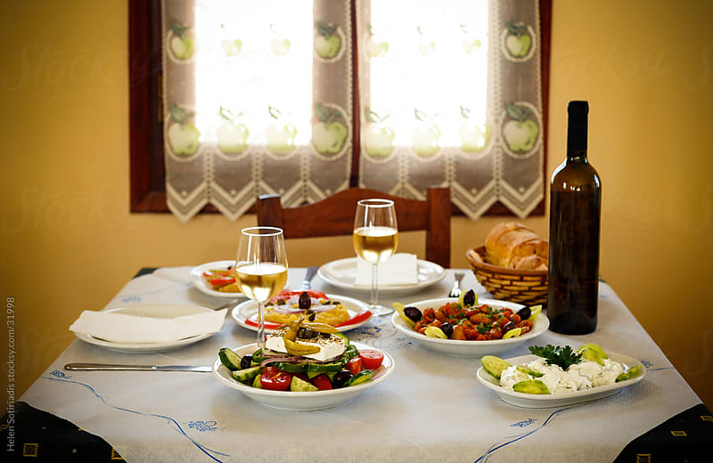 Appetizers laid out on a table in a Greek taverna by Helen Sotiriadis for Stocksy United