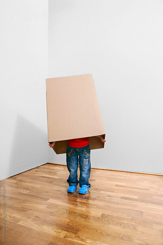 Kids playing with cardboard box by IDS Photography for Stocksy United