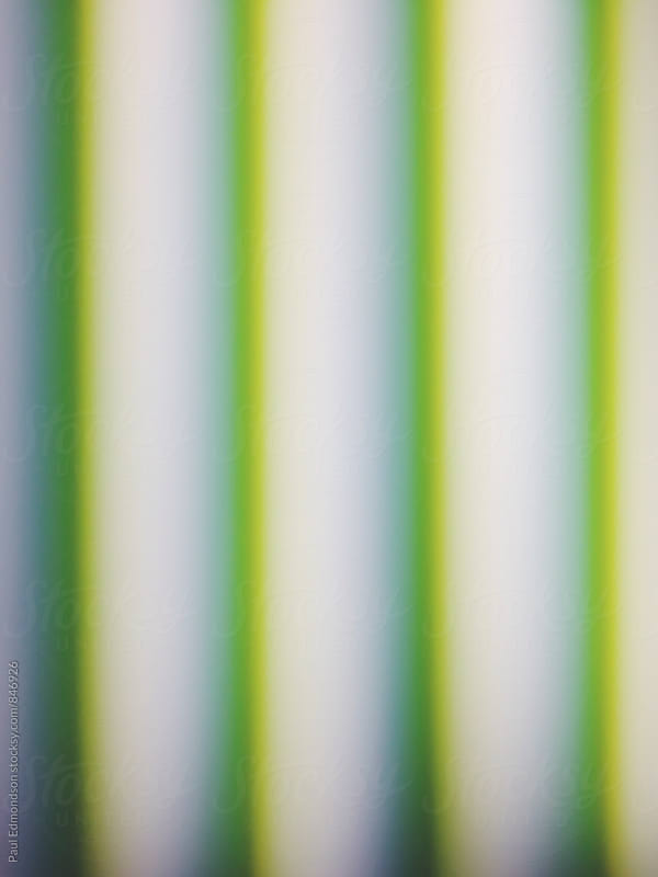 Abstract of glowing green and yellow lines from fluorescent lights by Paul Edmondson for Stocksy United