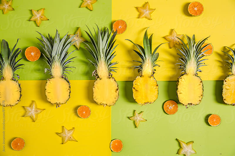 Pineapples in a row - tropical background by Jovo Jovanovic for Stocksy United