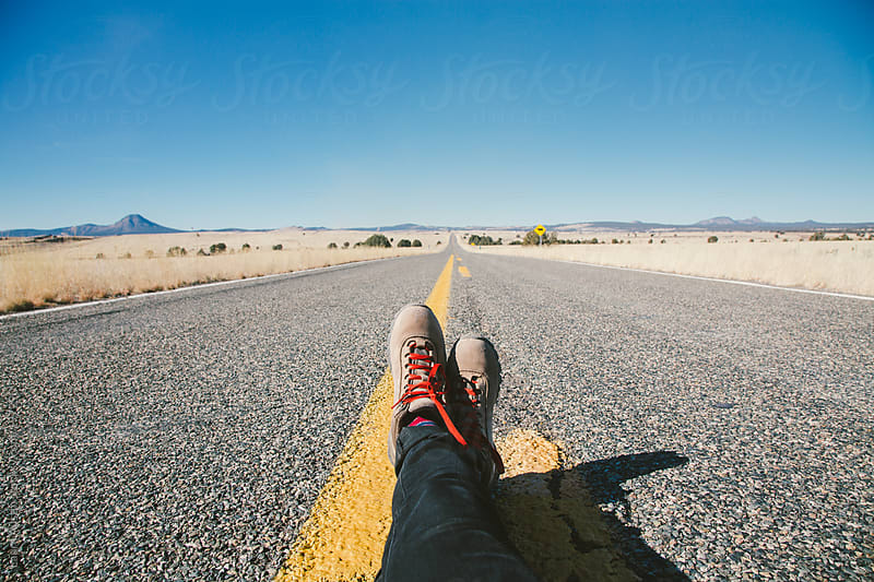 Feet on a Long Open Road by Laura Austin for Stocksy United