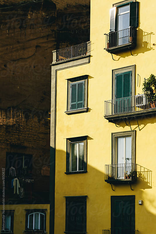 Yellow facade of a building in Naples, Italy by Aleksandar Novoselski for Stocksy United