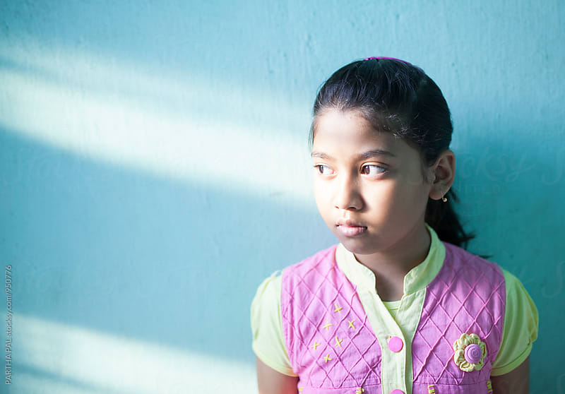 An Indian girl with emerging sunlight by PARTHA PAL for Stocksy United