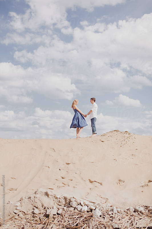 Couple on the beach by Irina Efremova for Stocksy United