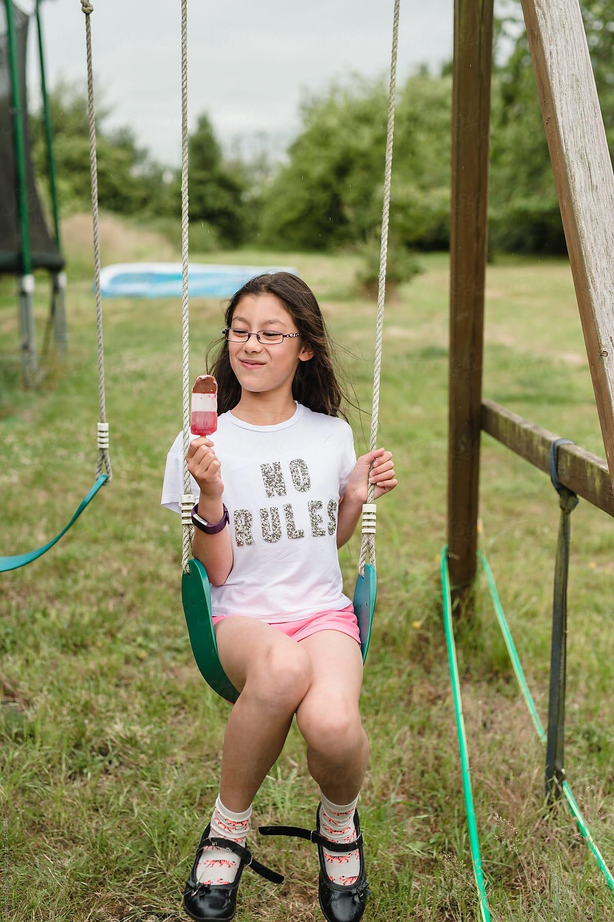 Beautiful Mixed Race Tween Girl Enjoying An Ice Lolly By Rebecca Spencer